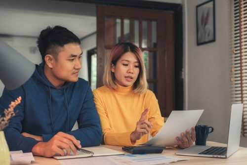 Couple discussing taxes in their home and online